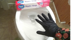 HOW TO USE PLASTIC WRAP TO UNCLOG A TOILET